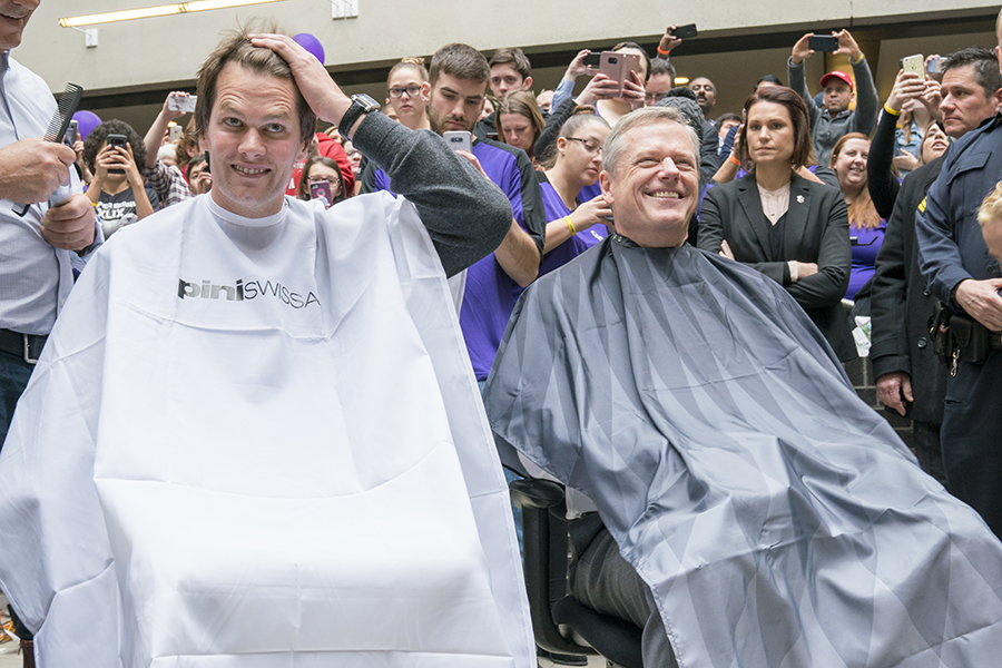 Tom Brady and Charlie Baker sit in barbers' chairs
