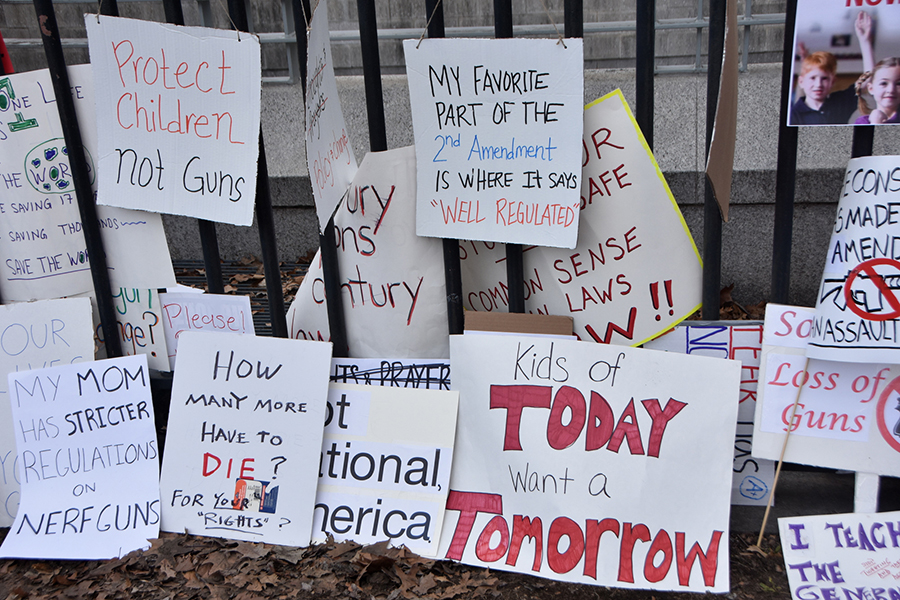 "Signs that say ""kids of today want a tomorrow"" and other messages of gun reform"