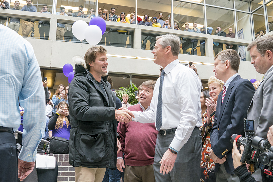 Tom Brady and Charlie Baker shake hands