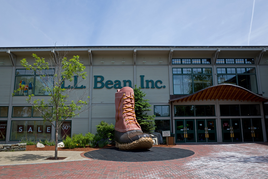 Freeport, Maine, USA-June 17, 2014: L.L.Bean is an American privately held mail-order, online, and retail company founded in 1912 by Leon Leonwood Bean. A replica of its famous boot stands in front of the store.