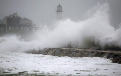 Waves crash against a seawall near the Scituate Lighthouse, Friday, March 2, 2018, in Scituate, Mass. A major nor'easter pounded the East Coast on Friday, packing heavy rain and strong winds as residents from the mid-Atlantic to Maine braced for coastal flooding.
