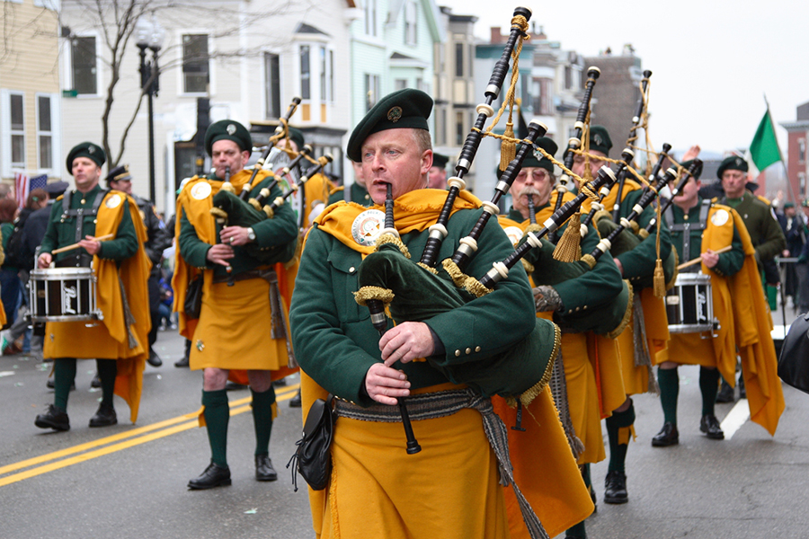 People play bagpipes in a parade