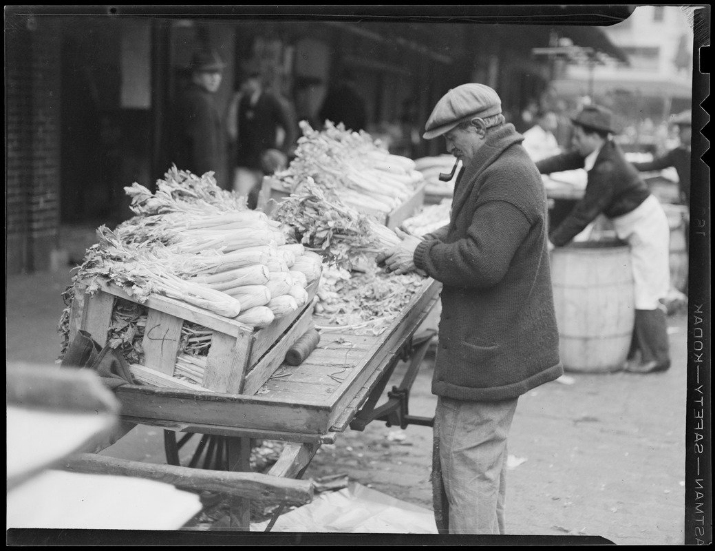 a man at a celery cart at quincy market