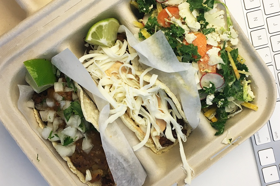 Two tacos and shaved salad to go from the Naco Taco food truck
