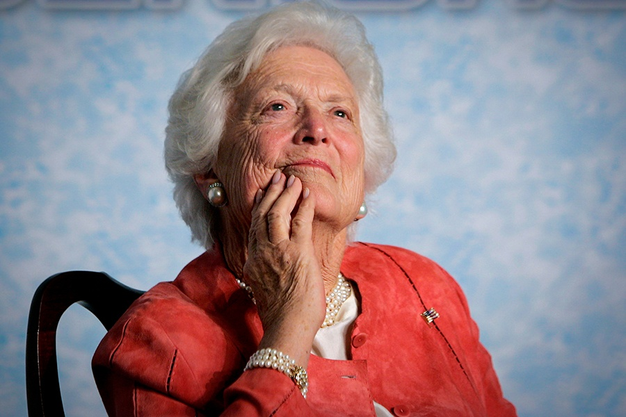 "In this file photo from Friday, March 18, 2005, former first lady Barbara Bush listens to her son, President George W. Bush, as he speaks on Social Security reform in Orlando, Fla. The wife of former President George H.W. Bush is in ""failing health,"" a Bush family spokesman said Sunday, April 15, 2018, following a recent series of hospitalizations and after consulting with her family and doctors, the 92-year-old former first lady has decided not to seek additional medical treatment and will instead focus on comfort care."
