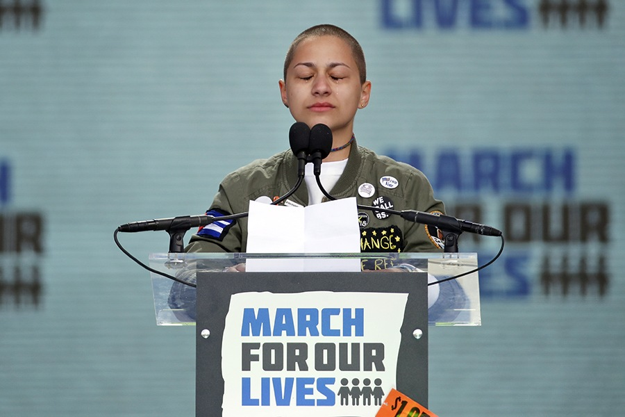 "Emma Gonzalez, a survivor of the mass shooting at Marjory Stoneman Douglas High School in Parkland, Fla., closes her eyes and cries as she stands silently at the podium for the amount of time it took the Parkland shooter to go on his killing spree during the ""March for Our Lives"" rally in support of gun control in Washington, Saturday, March 24, 2018."