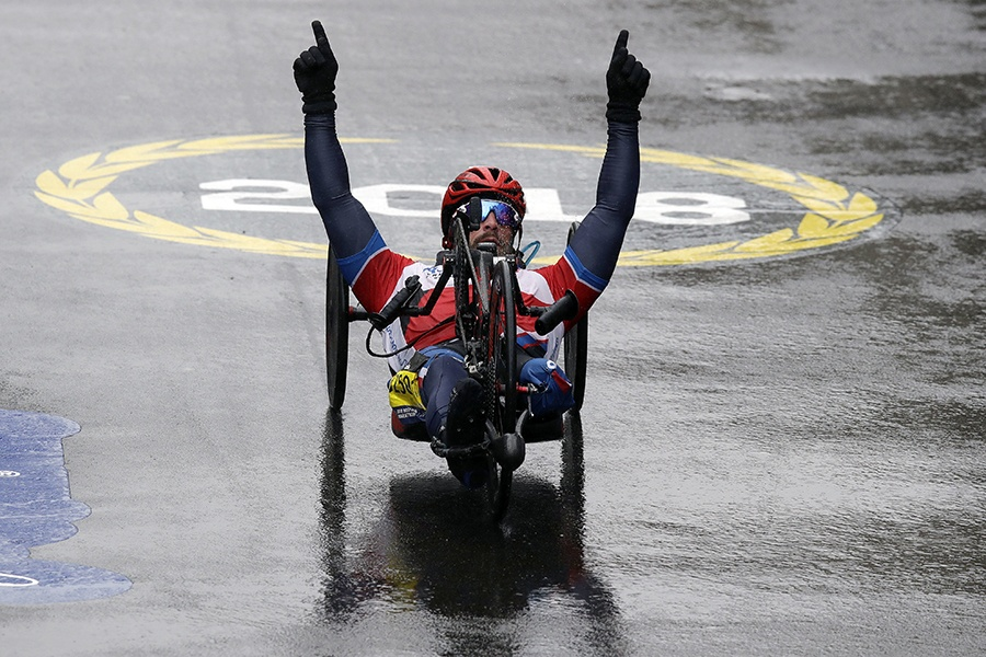 Tom Davis, of the United States, celebrates as he wins the handcycle division of the 122nd Boston Marathon on Monday, April 16, 2018, in Boston.
