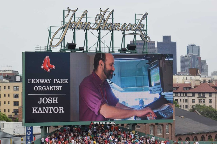 An image of Josh Kantor at the organ is projected on the jumbotron at Fenway Park