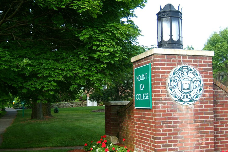 The Mount Ida college crest