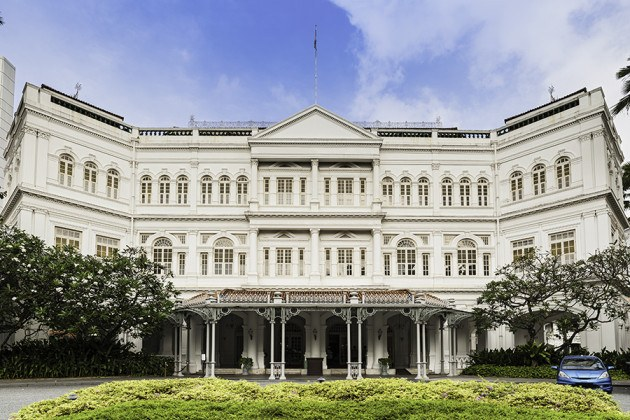 The imposing ornate Victorian facade of the 19th Century Raffles Hotel, iconic symbol of luxury and birthplace of the Singapore Sling cocktail. ProPhoto RGB profile for maximum color fidelity and gamut.