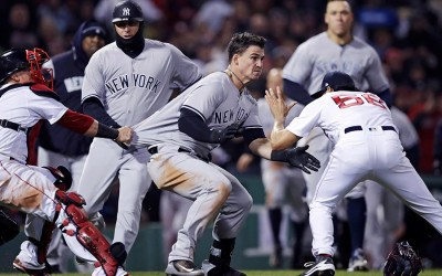 New York Yankees' Tyler Austin, center, rushes Boston Red Sox relief pitcher Joe Kelly, right, after being hit by a pitch during the seventh inning of a baseball game at Fenway Park in Boston, Wednesday, April 11, 2018.