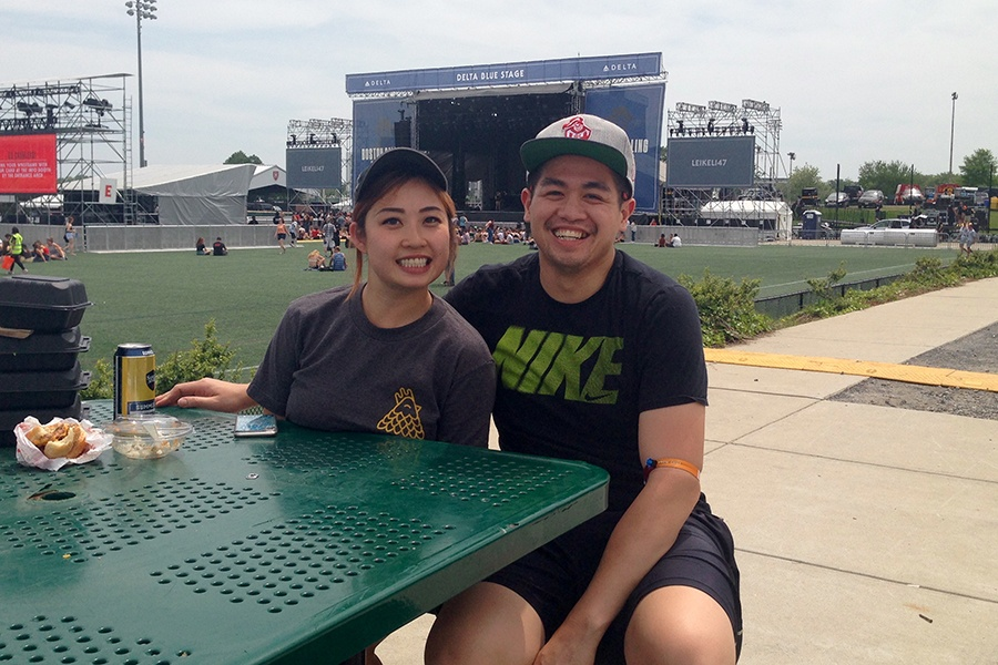 Food vendors Bataan Vo, 27, and Wilson Hui, 29, take a break by the Blue Stage