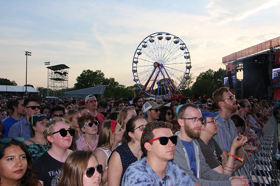 The crowd at Boston Calling as the sun sets with the Ferris wheel in the background