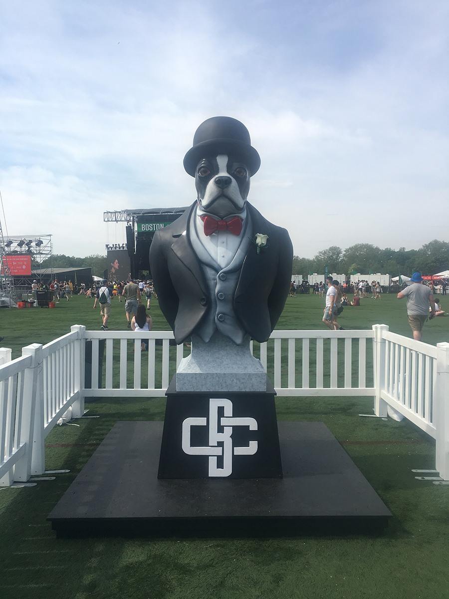 A sculpture of a French bulldog in a top hat and bow-tie