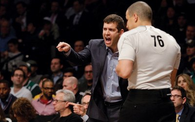 Boston Celtics head coach Brad Stevens argues with referee Steve Anderson (76) during the second half of an NBA basketball game against the Brooklyn Nets, Monday, March 23, 2015, in New York. The Celtics won 110-91.