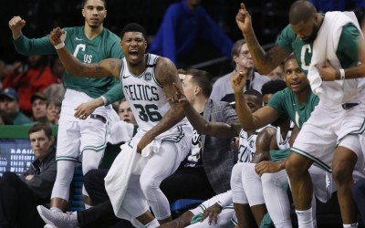 Boston Celtics players, from left, forward Jayson Tatum, guard Marcus Smart (36), forward Al Horford and forward Marcus Morris, far right, cheer from the bench during the fourth quarter of Game 1 of the NBA basketball Eastern Conference Finals against the Cleveland Cavaliers, Sunday, May 13, 2018, in Boston. The Celtics won 108-83.