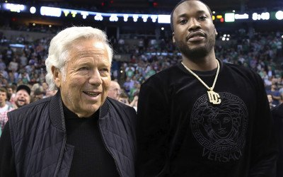 Rapper Meek Mill, right, stands with New England Patriots football team owner Robert Kraft at their seats for Game 2 of an NBA basketball second-round playoff series between the Boston Celtics and the Philadelphia 76ers, Thursday, May 3, 2018, in Boston.