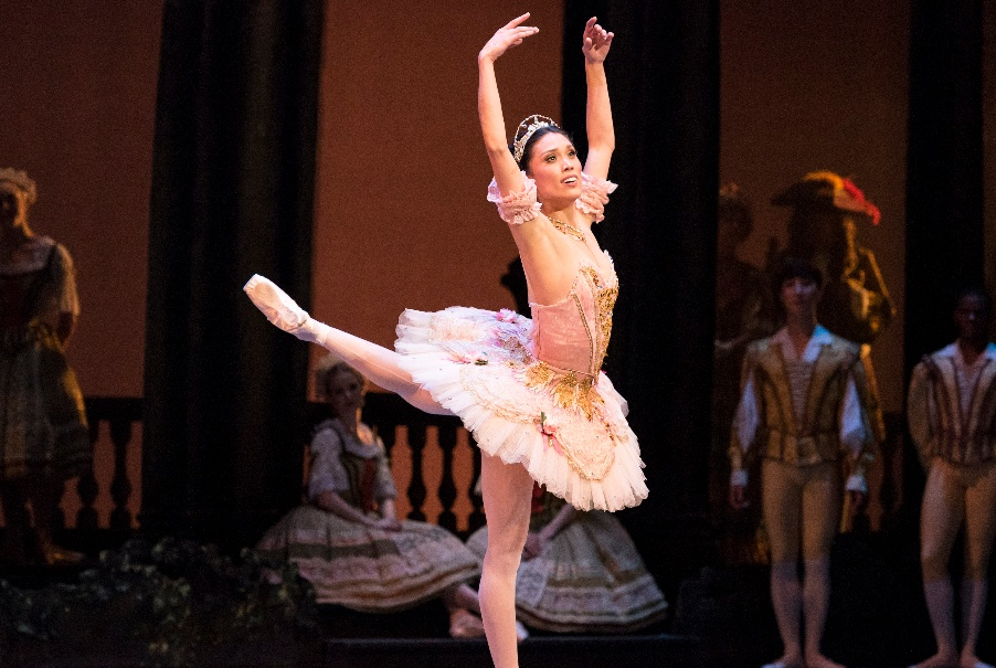 A ballerina stands on pointe