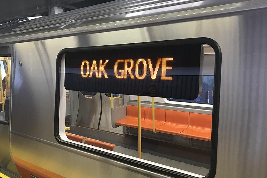 A sign that reads Oak Grove