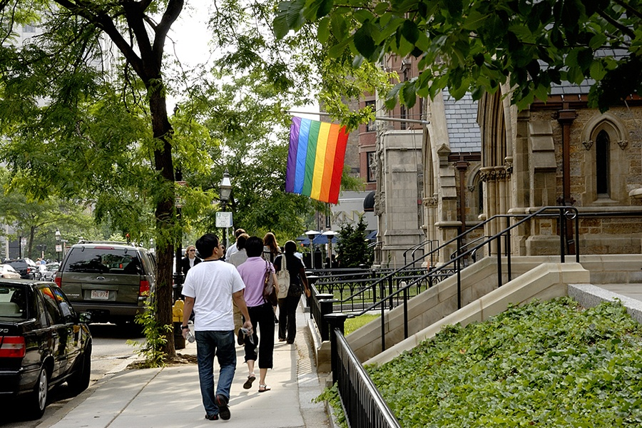 A rainbow flag hangs on a street in Boston