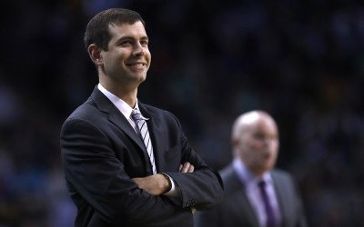 Boston Celtics head coach Brad Stevens smiles during the first quarter of an NBA basketball game in Boston, Wednesday, Feb. 28, 2018
