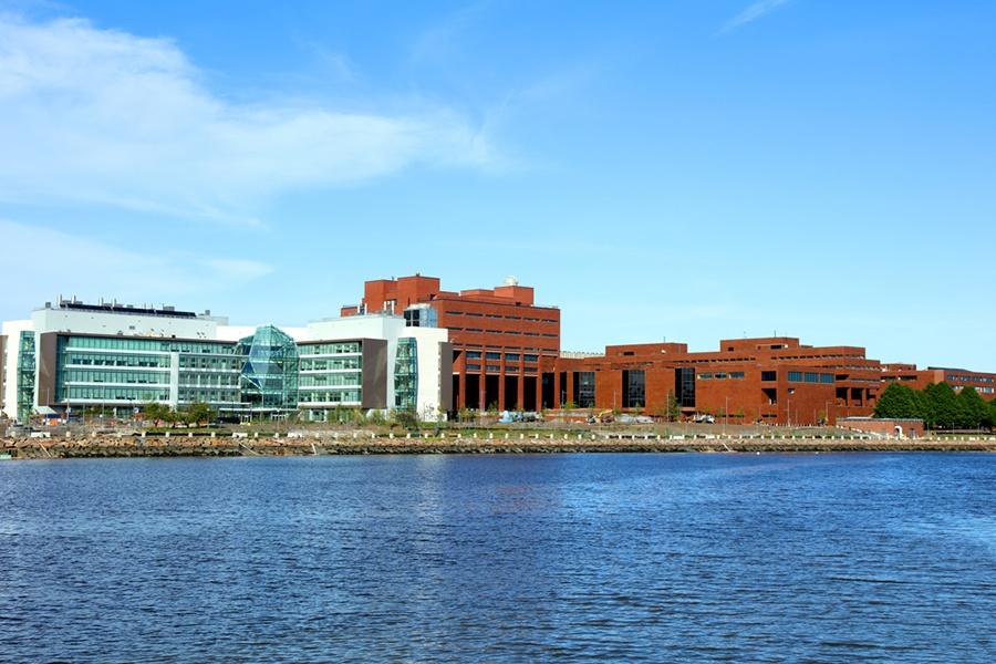 Boston, Massachusetts, USA - May 21, 2017: Daytime view of the University of Massachusetts Boston campus along the Boston Harborwalk