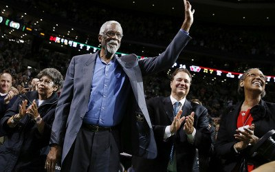 Boston Celtics great Bill Russell waves to the crowd during a tribute in his honor in the second quarter of an NBA basketball game between the Celtics and the Milwaukee Bucks in Boston, Friday, Nov. 1, 2013.