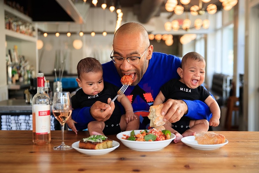 Chef Douglass Williams and his sons, Raffa and Lev, eat a super-sized bowl of pasta at Mida