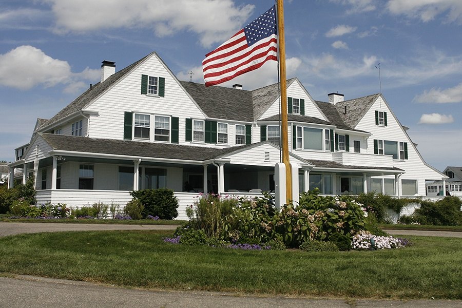 A beautiful home with an American flag in front of it