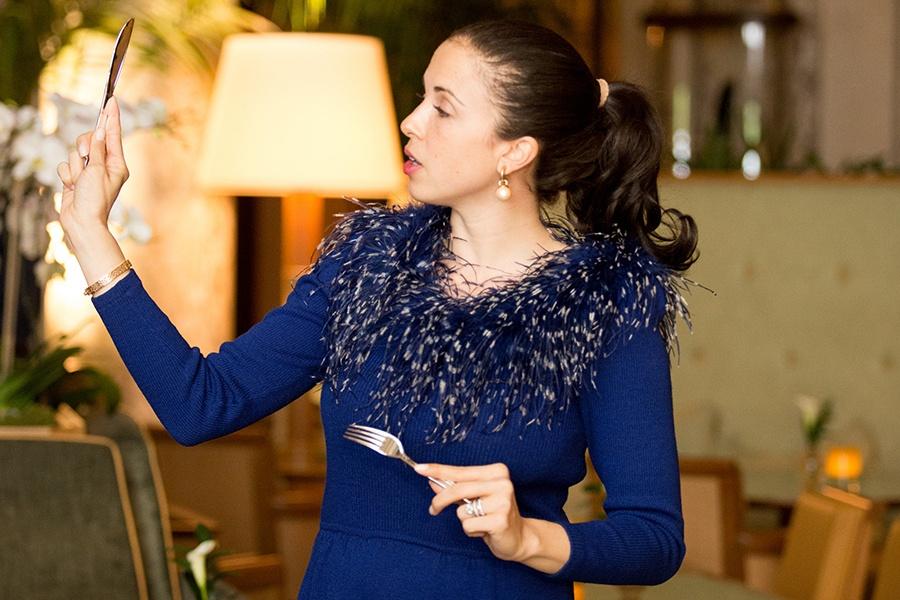 Myka Meier holds up a fork and knife