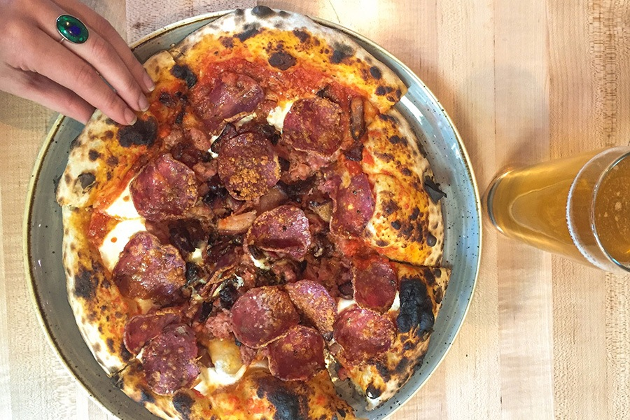 The South End location of Area Four has a new rotating pizza-and-beer special every day