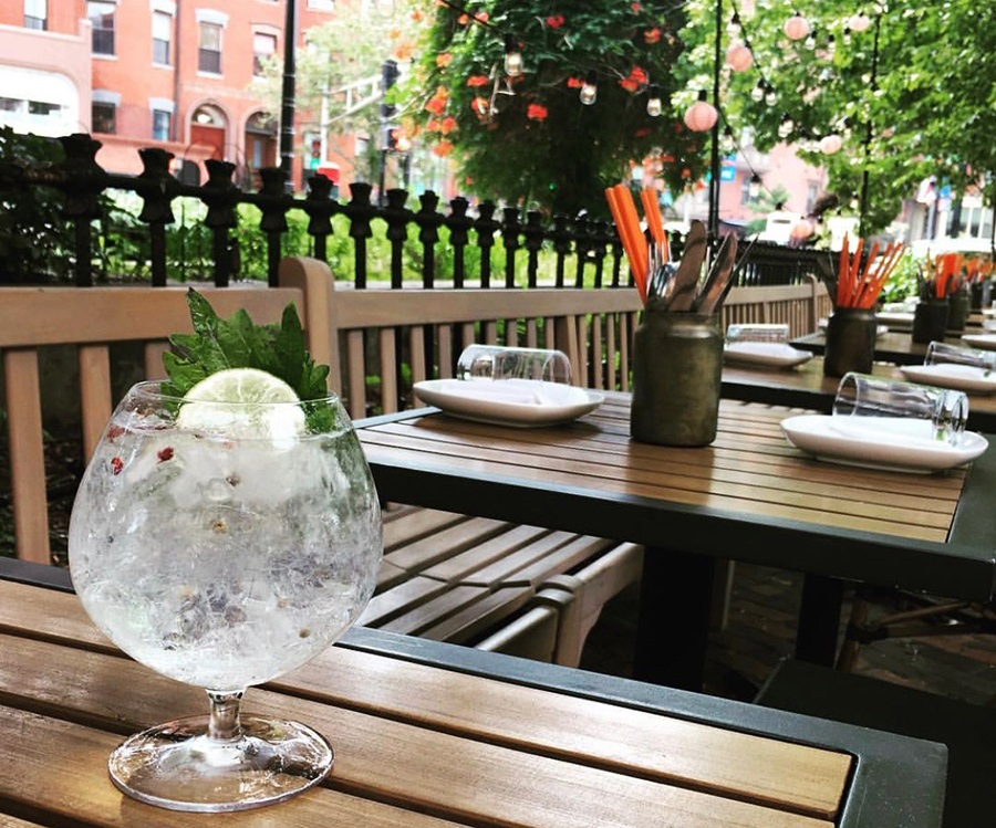 A gin and tonic with shiso on the patio at Banyan Bar + Refuge