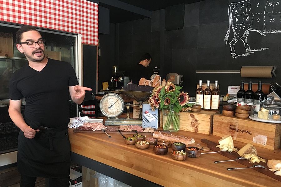 Matt, a longtime server at the Butcher Shop, describes a spread of charcuterie during a recent happy hour