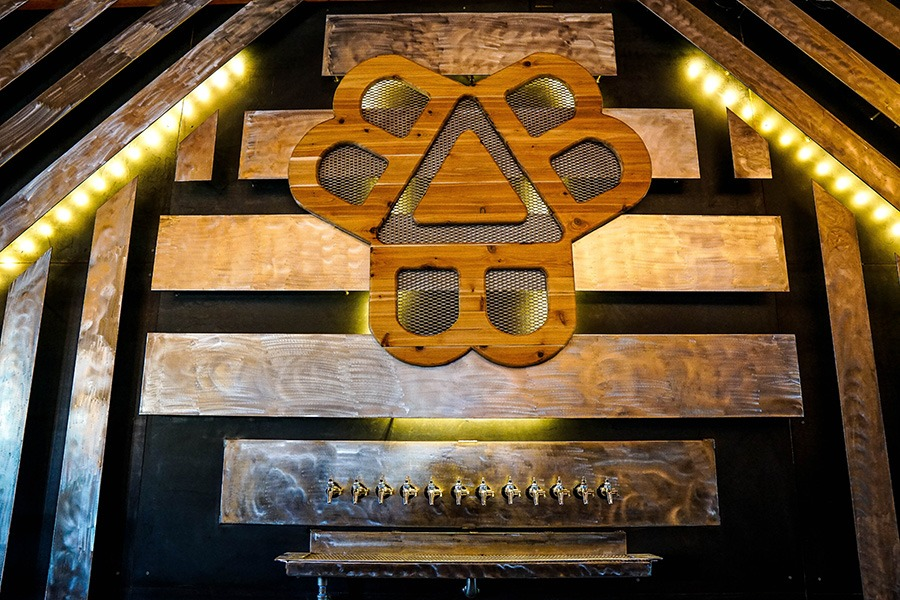 The Bissell Brothers logo adorns the bar at the new Three Rivers taproom in Milo, Maine