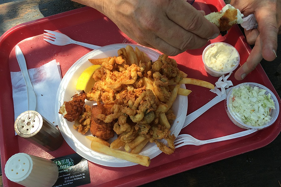 The author's father digs into tartar sauce with a clam cake at Captain Frosty's