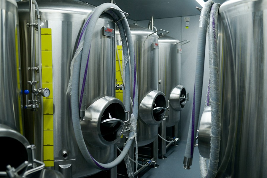 Serving tanks in the basement cold room at Democracy Brewing