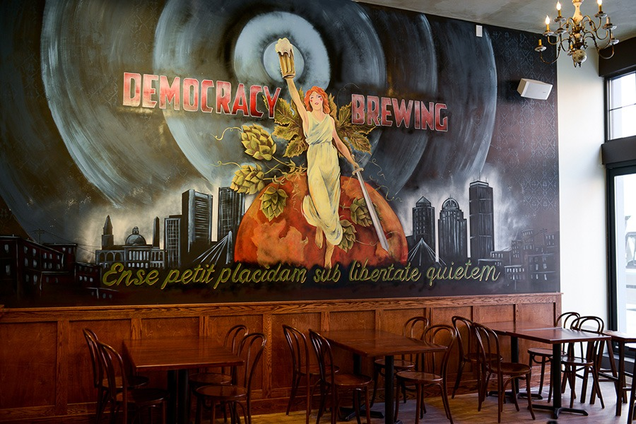 Boston artist Mark Grundig painted a mural and more wall decor at Democracy Brewing