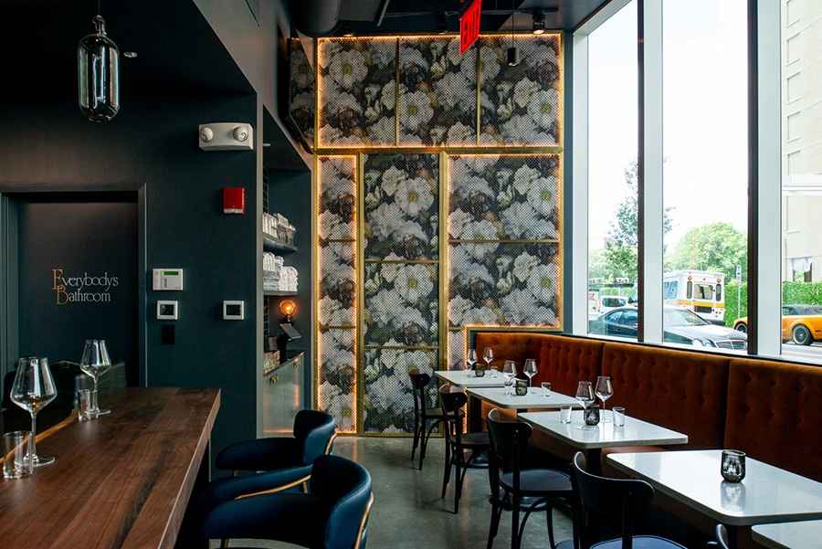 A bold floral wall hides wine storage at Nathálie Wine Bar.