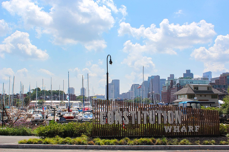 The Castle Island beer garden at Constitution Wharf overlooks Boston Harbor and the skyline