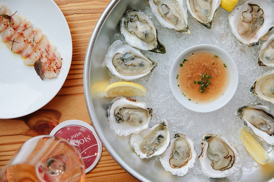 East Coast oysters on the half shell, seasonal crudo, more affordable rose options, and more are new to the menu at Moon Bar.