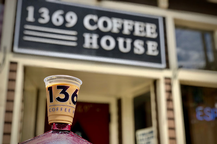 Ice coffee in front of 1369 Coffee House in Inman Square