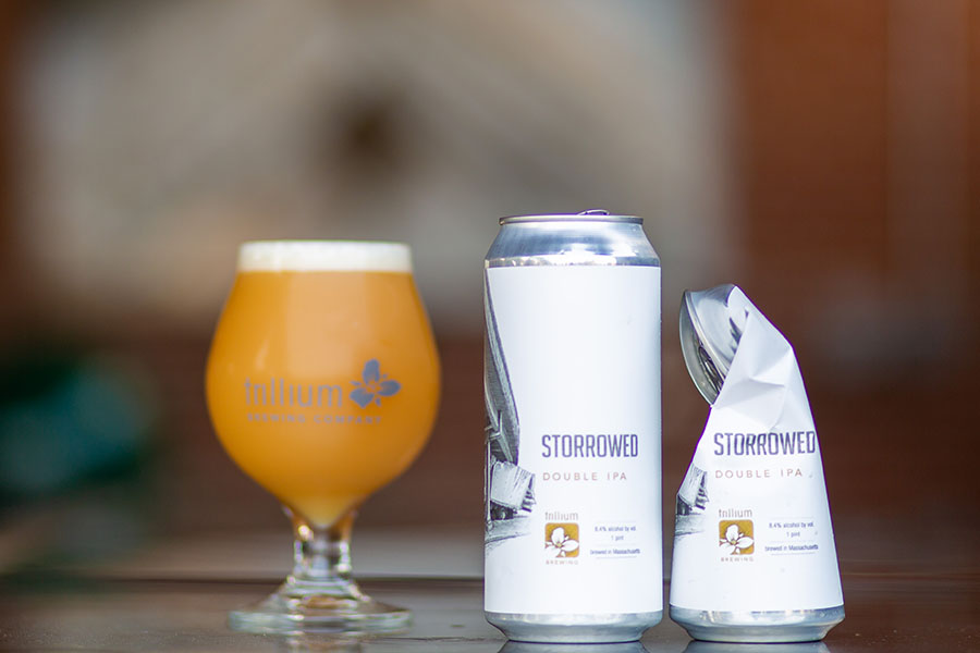 a pint, can, and crushed can of Trillium Brewing Storrowed double IPA
