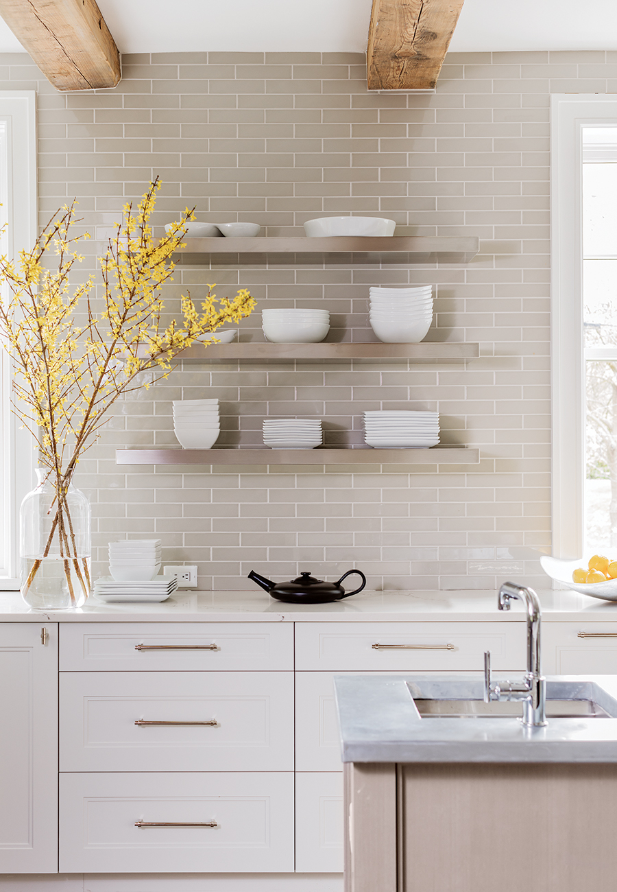 The Pale Gray Ceramic Backsplash Tile With White Grout Adds A Hint Of  Texture To The Sunny Space. / Photograph By Michael J. Lee