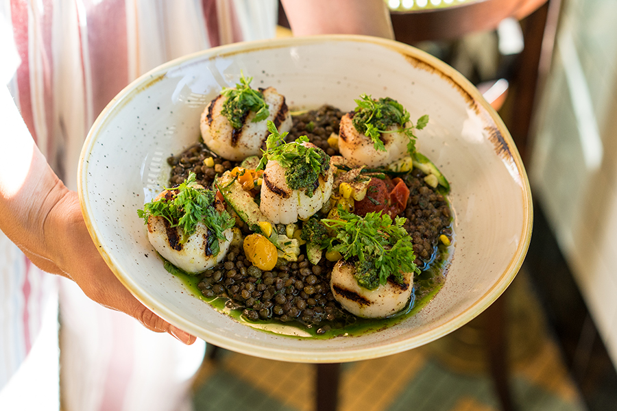Grilled scallops with le puy lentils are one dish on Explorateur's pre-theater prix-fixe menu.