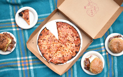 A crispy-edged bar pizza and roast beef sandwiches from Hot Box, now open at Bow Market.