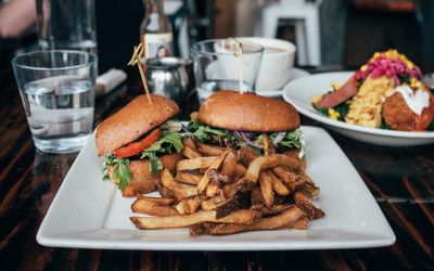 A burger and fries at Rewild Plant Food + Drink