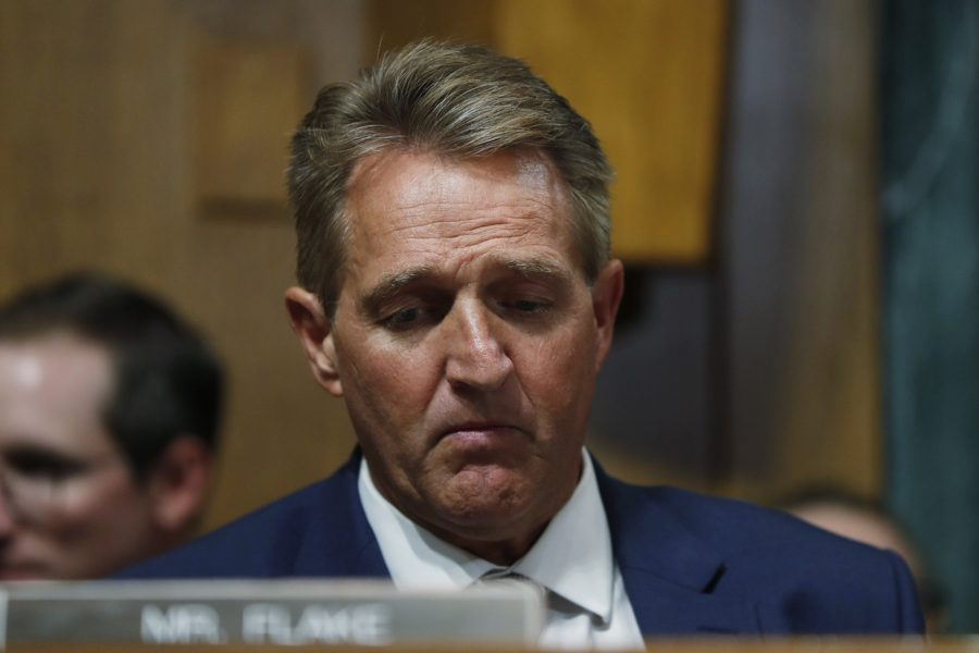 'Look at me:' Women confront Flake on Kavanaugh support