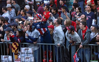 Red Sox fans cheer the team during the 2013 World Series victory parade in Boston