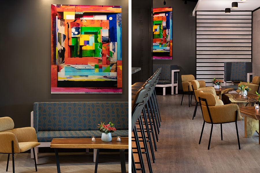 "The ""living room"" at Alcove has comfortable sofas and low tables, plus colorful art by Quinn Gorbutt"