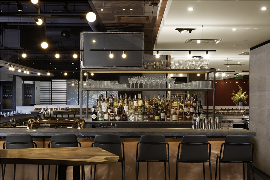 A 35-seat, U-shaped bar dominates the room at Alcove